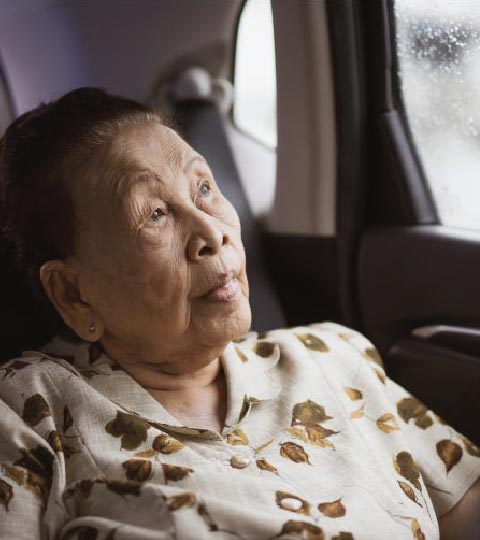 An Old Woman using our Houston Chauffeur service to get to her doctor's appointment
